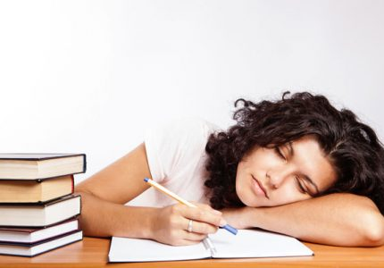 Neurons in the brain: white background image of female student sleeping at the desk.