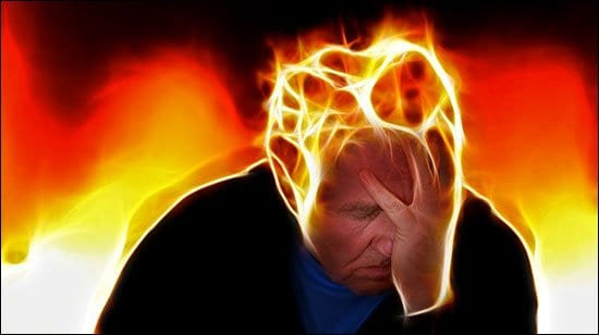 Symptoms of acidosis: image of man having a headache.