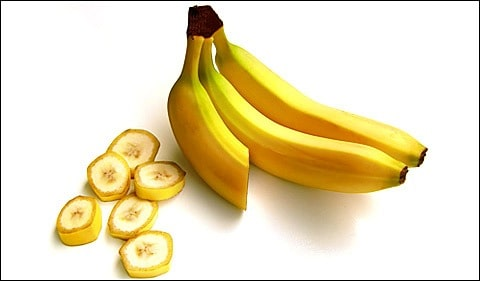 3 bananas on white background.