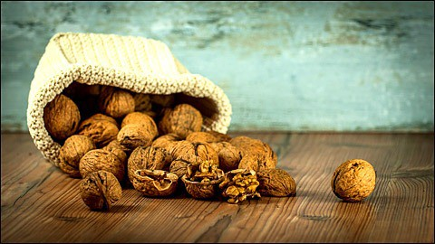 Walnuts on the wooden table.